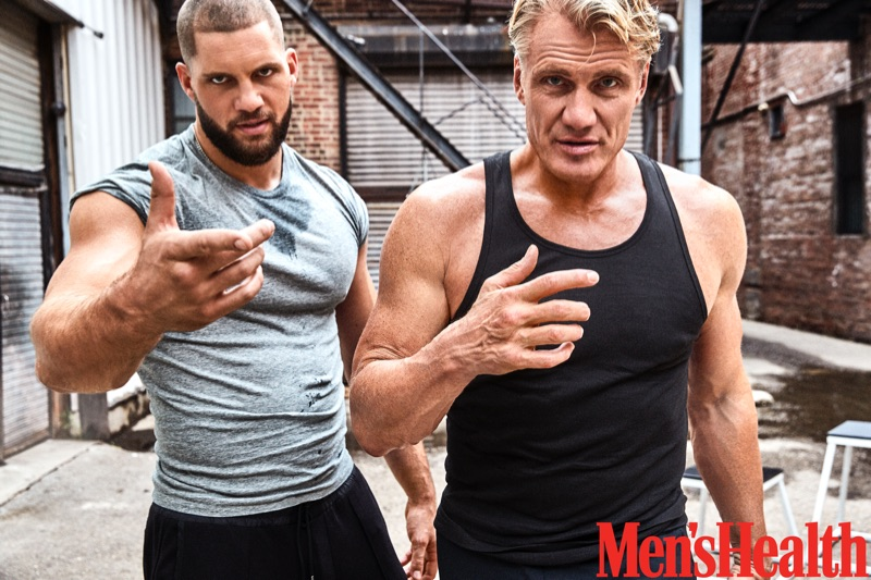 Pictured Left to Right: Florian Munteanu wears an Armani Exchange t-shirt and Michael Kors joggers. Dolph Lundgren sports a Calvin Klein tank with Under Armour joggers.