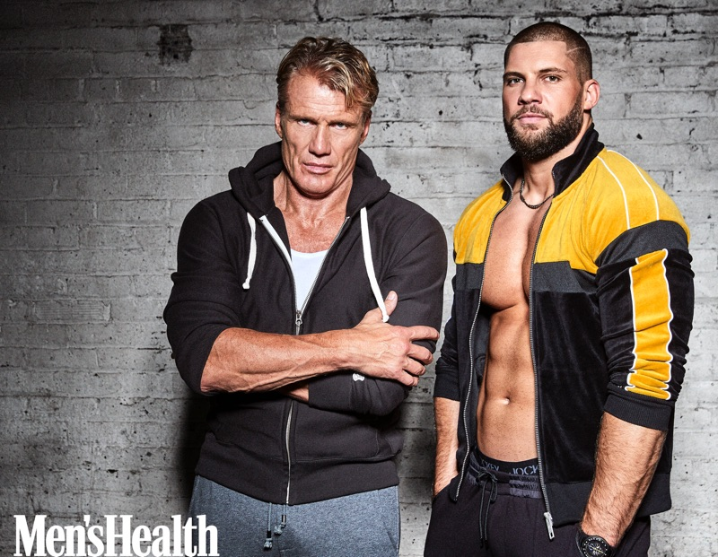 Actors Dolph Lundgren and Florian Munteanu come together for Men's Health. Lundgren wears a Todd Snyder + Champion sweatshirt with a Jockey tank and Russell Park joggers. Munteanu rocks a Tommy x Lewis track jacket, Jockey underwear, and Michael Kors joggers.