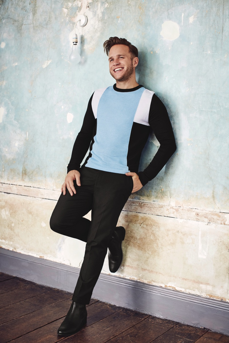 Embracing the latest fashion trends, Olly Murs dons a color block sweater from his River Island collaboration.