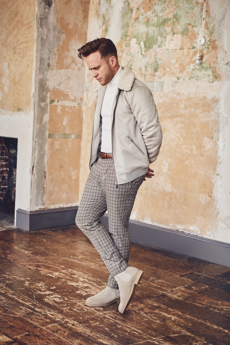 A chic vision, Olly Murs wears a faux suede fleece collar jacket and cropped check trousers from his River Island collaboration.