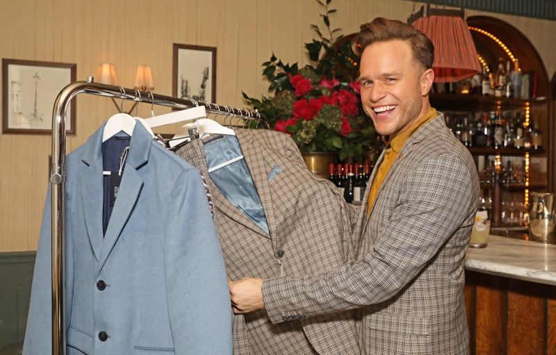 Celebrating the launch of his River Island collection, Olly Murs shows off pieces at an intimate dinner.