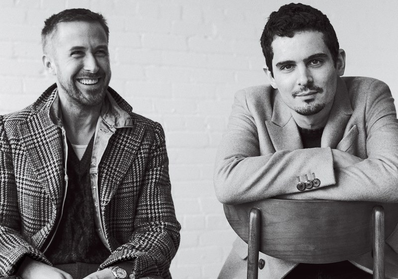 All smiles, Ryan Gosling joins Damien Chazelle for GQ. Gosling wears a Gucci coat with his Levi's jacket and sweater vest. He also dons a Calvin Klein tank and Ralph Lauren pants. Meanwhile, Chazelle sports a Prada coat and sweater with his own pants.