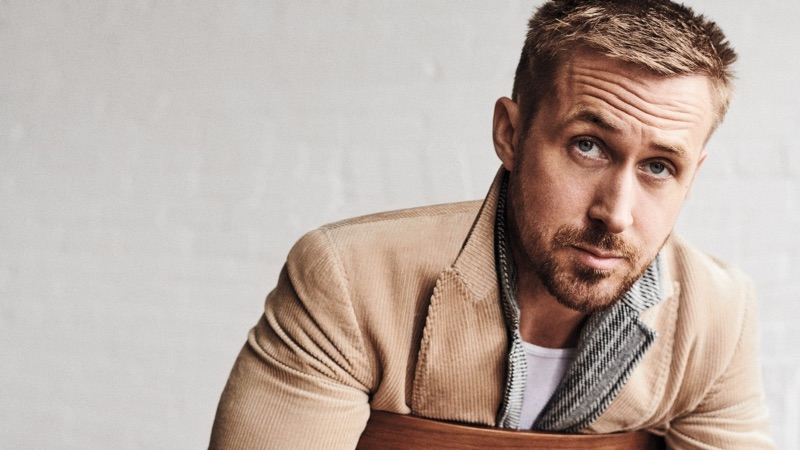 Actor Ryan Gosling sports a Dolce & Gabbana coat with a Z Zegna polo.