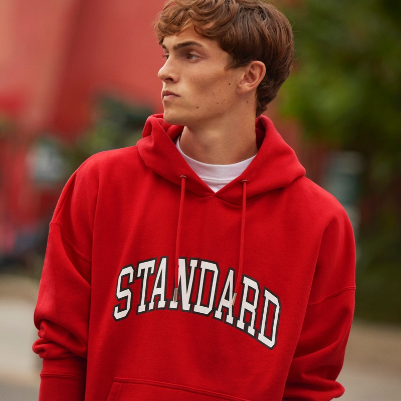 """Going casual, Luc Defont-Saviard sports a """"Standard"""" red hoodie from Sandro."""