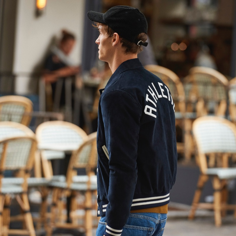 Heading out, Luc Defont-Saviard wears a corduroy varsity jacket from Sandro.