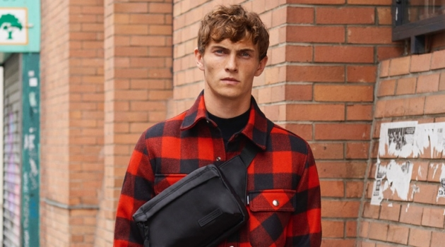 Luc Defont-Saviard sports a Sandro red and black checked jacket lined with faux sheepskin.