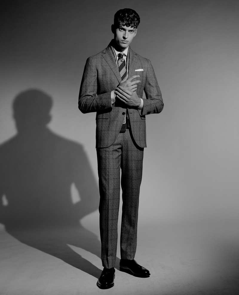 Azim Osmani wears a Boggi Milano suit and shirt with a tie and shoes by Ermenegildo Zegna.
