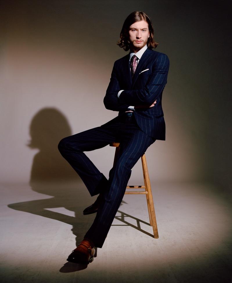 Louie Johnson dons a Paolini suit, Alessandro Gherardi shirt, Gabriele Pasini tie, Orciani belt, and Santoni shoes.