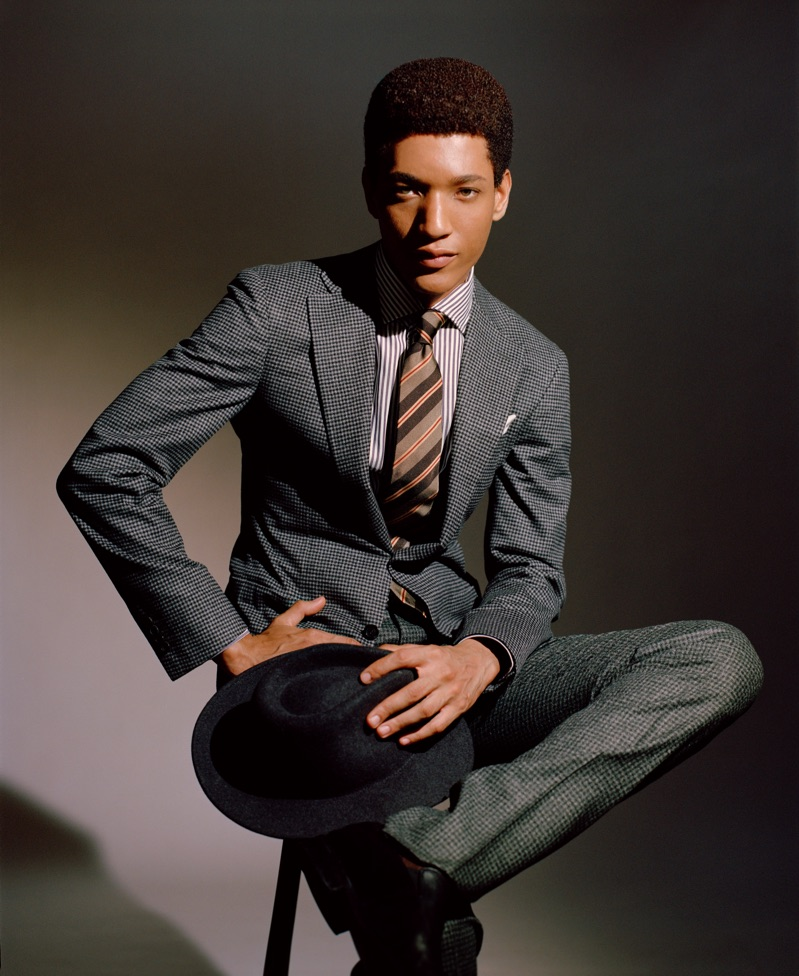 Peter Finn models a Canali suit, Ingram shirt, and Giorgio Armani hat.