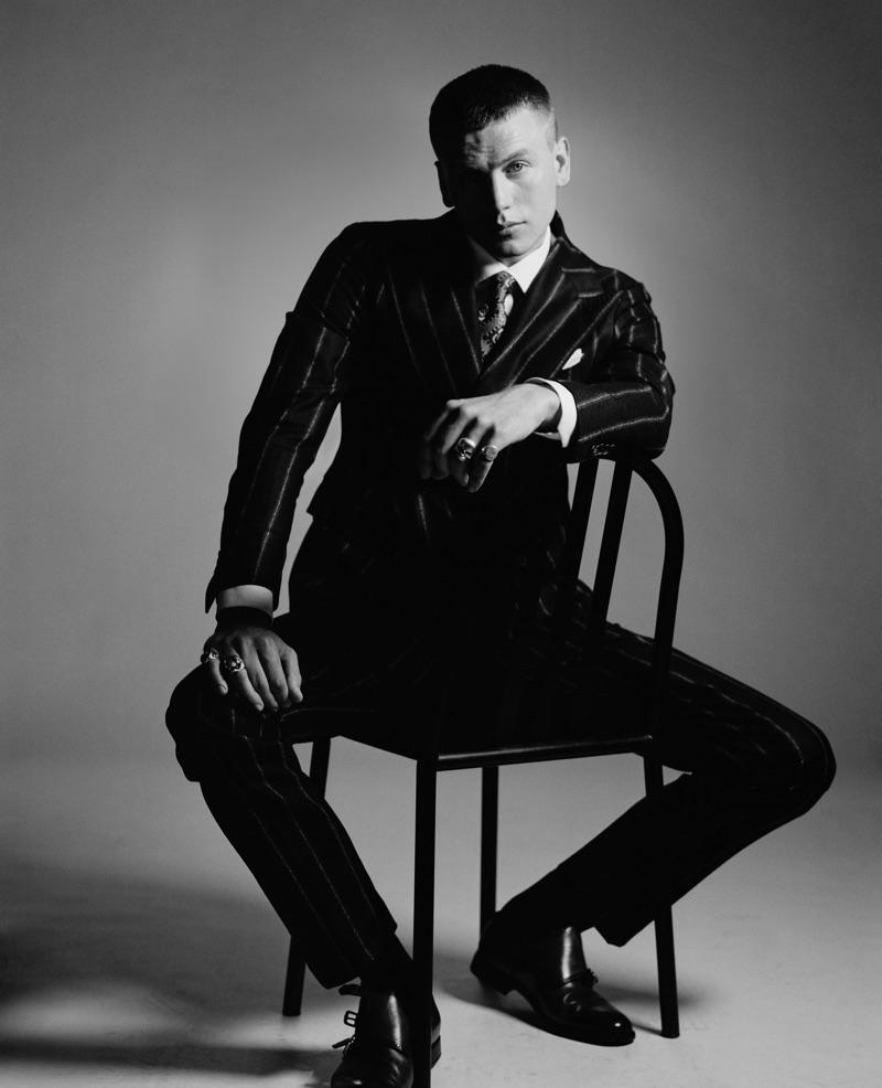 Sid Ellisdon sports a Tagliatore suit, Gabriel Pasini tie, Ermenegildo Zegna shirt, Perofil socks, and Fratelli Rossetti shoes.