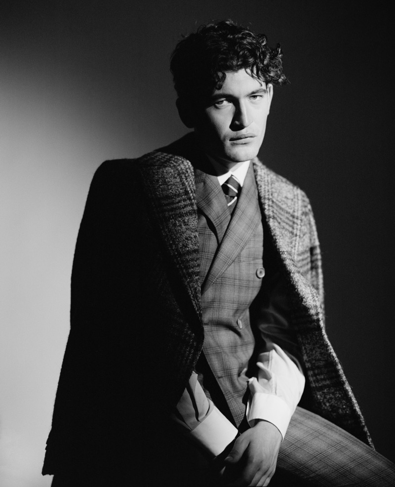 Dylan Hartigan dons a Sartoria La Torre coat and Pal Zileri three-piece suit with a shirt and tie by Corneliani.