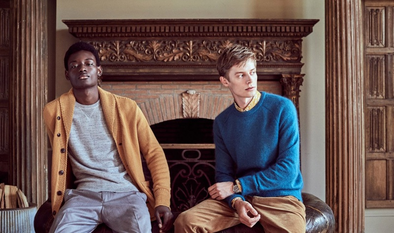 Left to Right: Youssouf Bamba dons a brass yellow shawl cardigan sweater, grey cashmere sweater, and light grey trousers. Janis models a bright blue Italian brushed wool sweater and caramel-colored 5-pocket pants.