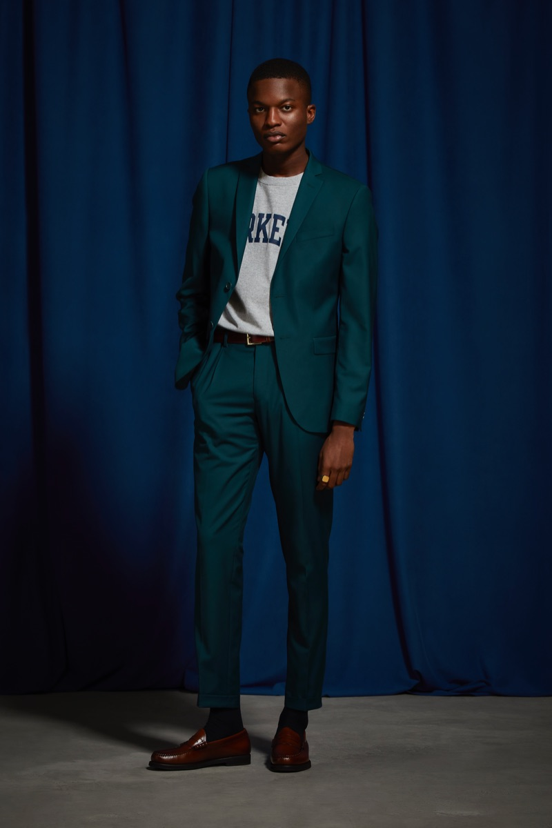 Christopher T. Smith sports an UO teal relaxed fit blazer and suit pants.
