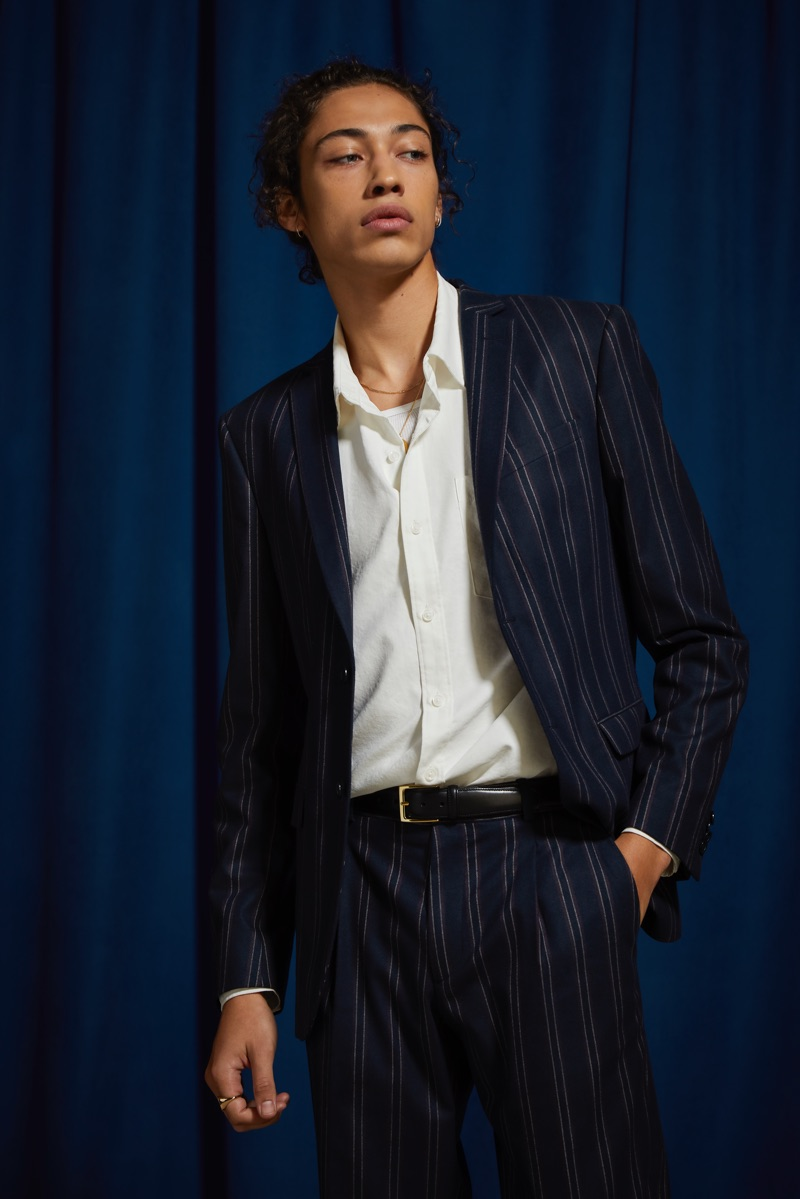 Making a case for pinstripes, Max Fieschi dons a navy pinstripe blazer and suit pants by UO.