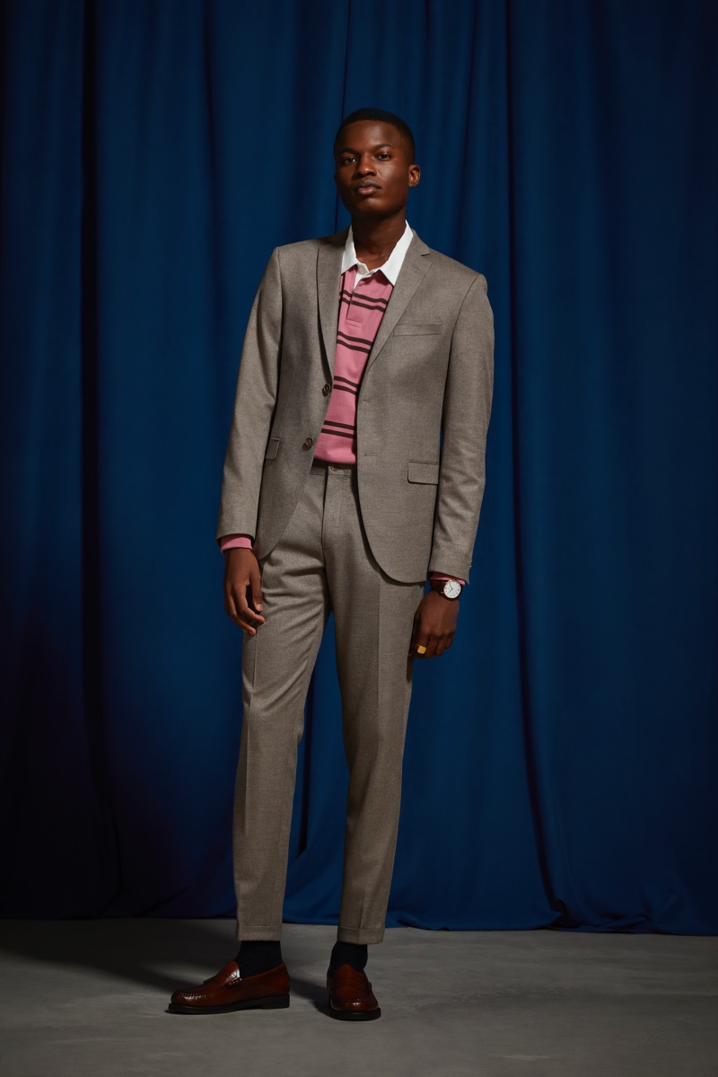 A smart vision, Christopher T. Smith wears an UO marled tan relaxed fit blazer and suit pants.