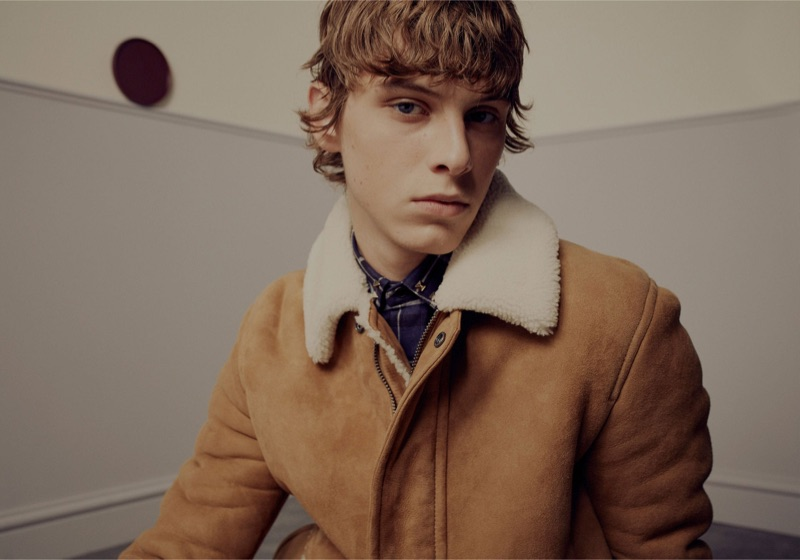 Serge Sergeev dons a shearling coat and checked shirt by Valentino.