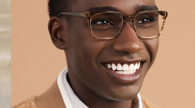 All smiles, Bakay Diaby dons Warby Parker's Hughes glasses in Chestnut Crystal.