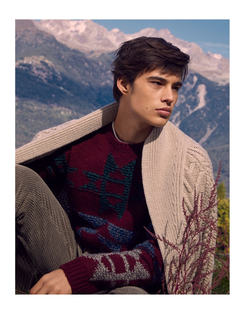 Louis Baines layers in knitwear from YOOX. He also sports corduroy pants.