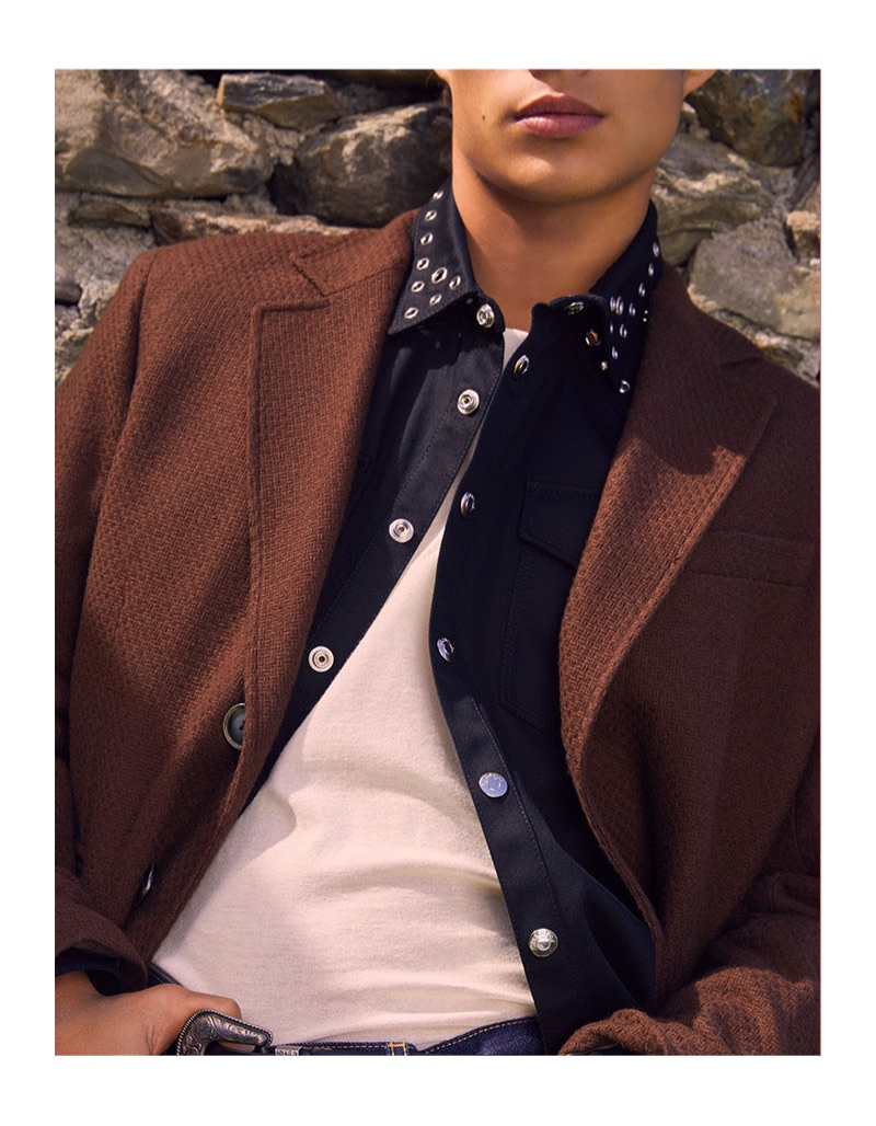 Connecting with YOOX, Louis Baines wears an oversized coat with a Valentino Garavani western-style shirt.