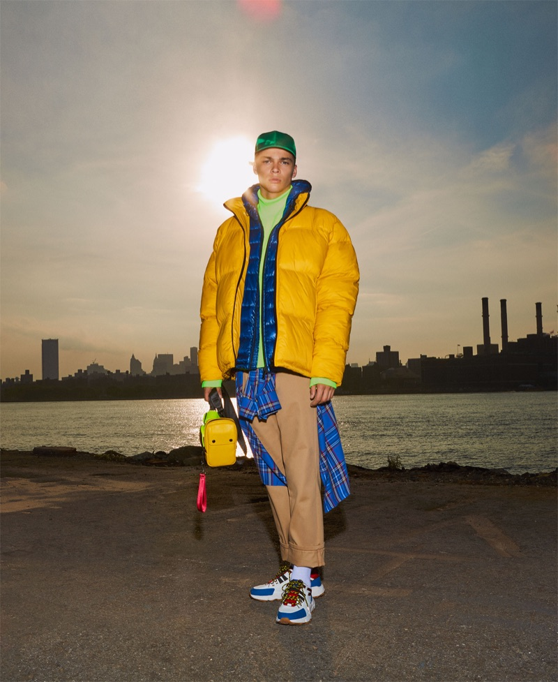 Making a statement in yellow, Leonard Mushiete sports a Zara Man puffer jacket.