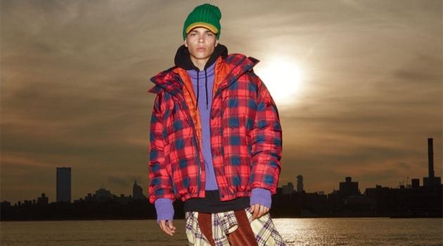 Reuniting with Zara, Leonard Mushiete wears a bold checkered puffer jacket.