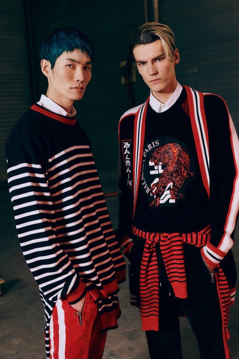 Jo Wonil and Elias de Poot don knitwear from Balmain's pre-fall 2019 men's collection.