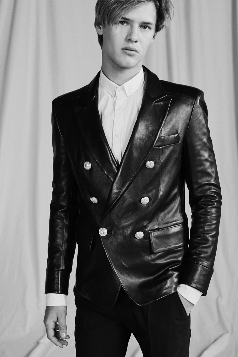 Front and center, Emil Wikstrom rocks a leather double-breasted jacket from Balmain's pre-fall 2019 men's collection.