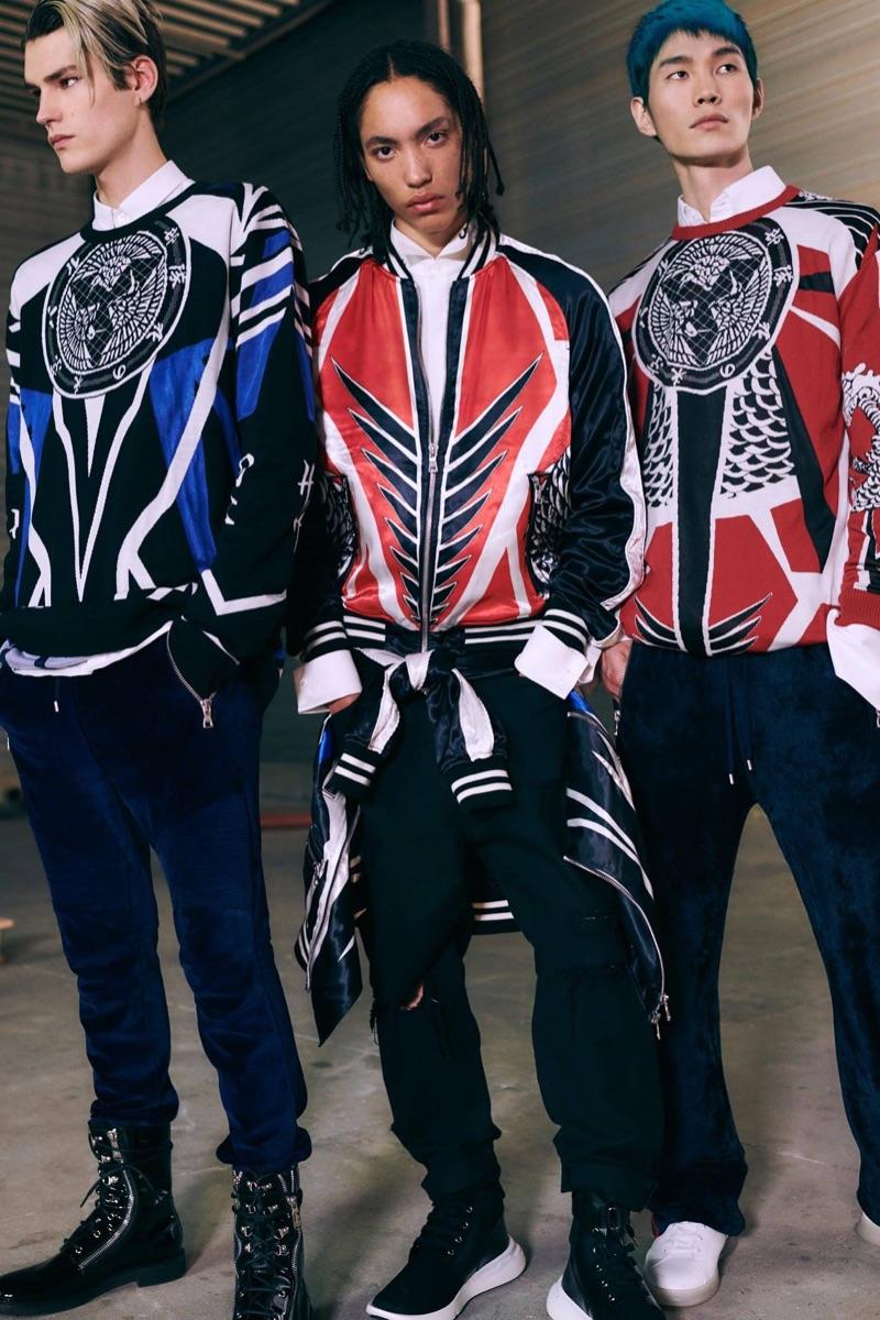 Embracing a streetwear-inspired edge, models Elias de Poot, Andrew Nelson, and Jo Wonil wear Balmain.