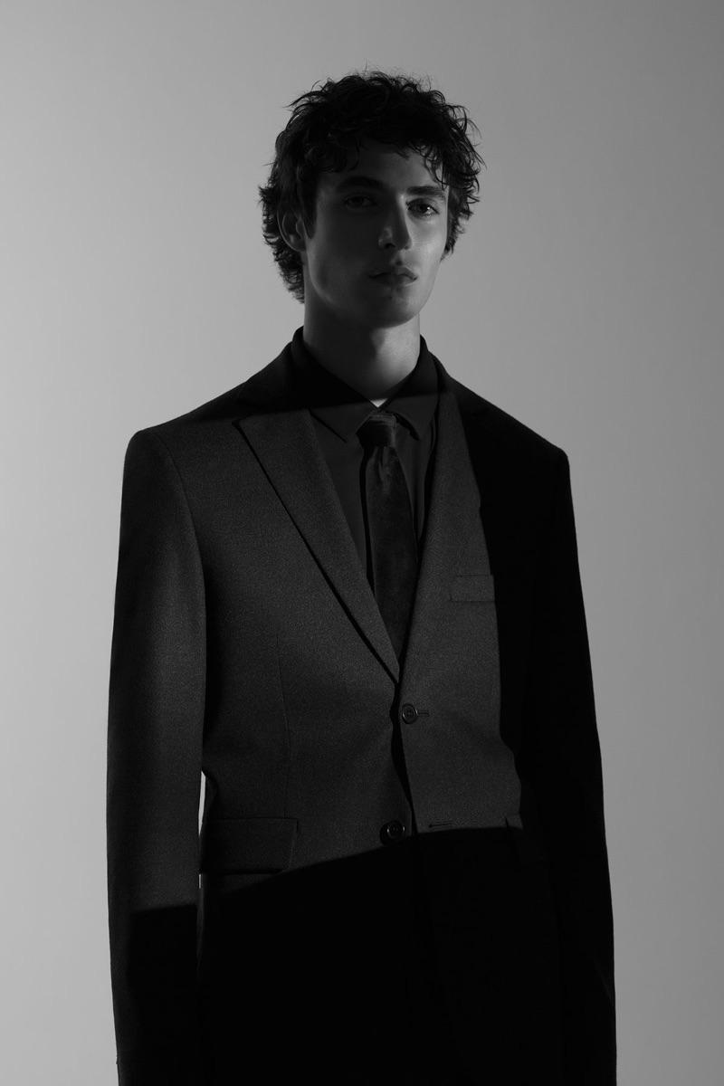 Oscar Kindelan dons a black on black suit number from COS.