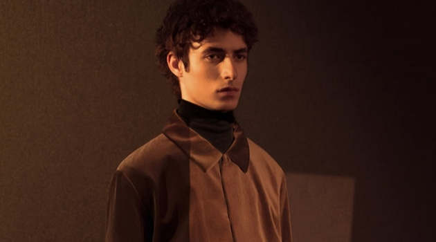 Warming up to velour, Oscar Kindelan wears a coordinated outfit by COS.