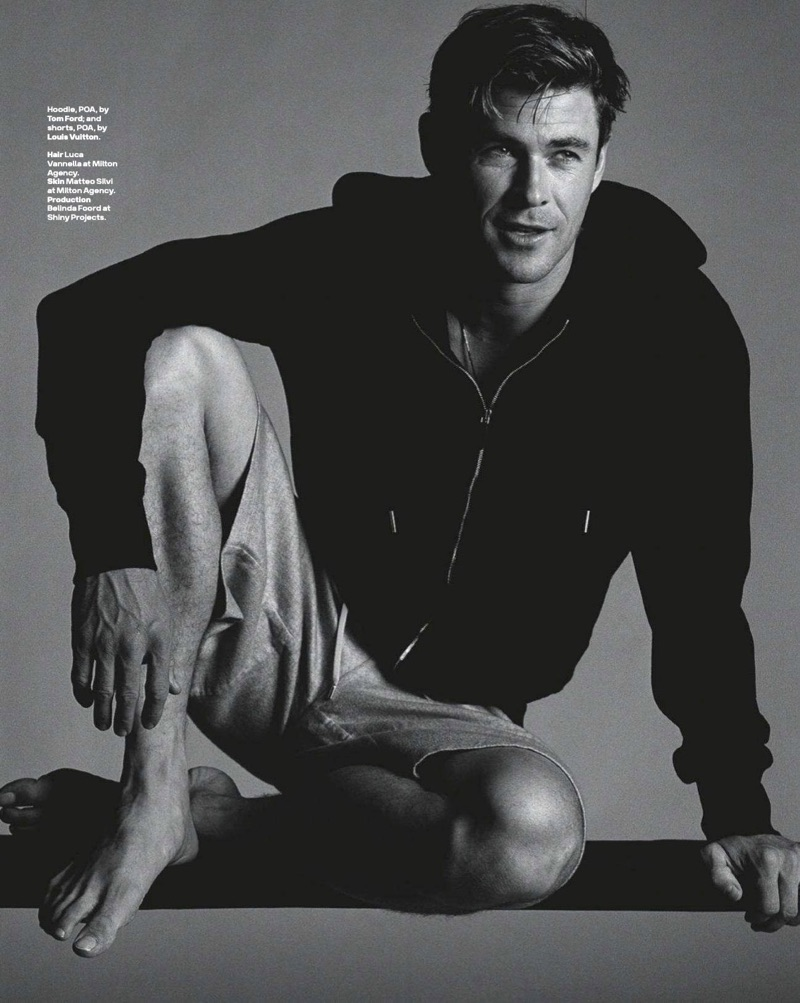 Appearing in a GQ Australia photo shoot, Chris Hemsworth wears a Tom Ford hoodie and Louis Vuitton shorts.