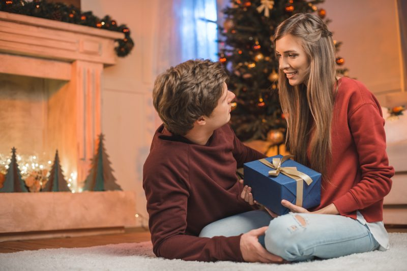 Christmas Couple Exchanging Gifts