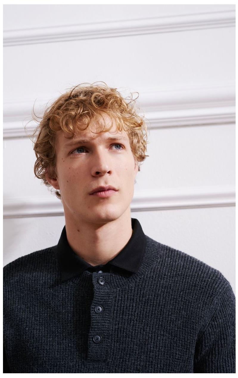 Sven de Vries dons a Club Monaco plaited henley sweater.