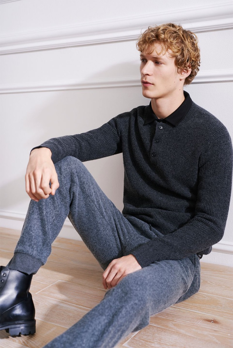 Layering for the cold, Sven de Vries sports a Club Monaco plaited henley sweater, brushed zip sweatpants, and a corduroy shirt. He also wears Wings & Horns officer boots.
