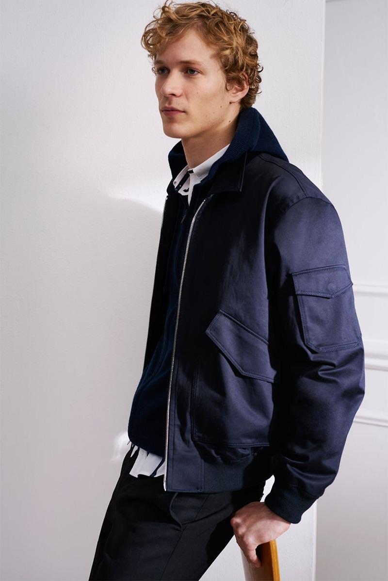 Dutch model Sven de Vries wears a Club Monaco aviator bomber, striped shirt, donegal zip hoodie, and pants.