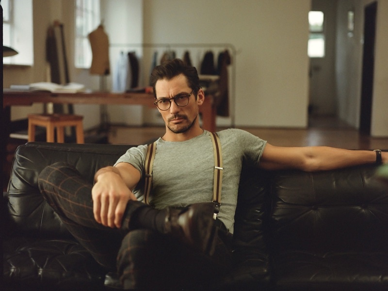 David Gandy is a smart vision in a fitted t-shirt, suspenders, and windowpane print trousers.