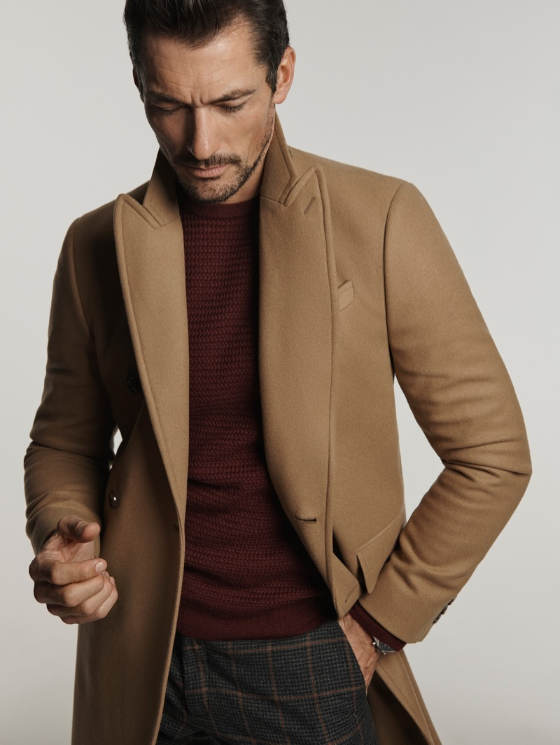 Donning a camel coat, David Gandy champions menswear essentials from Mango.