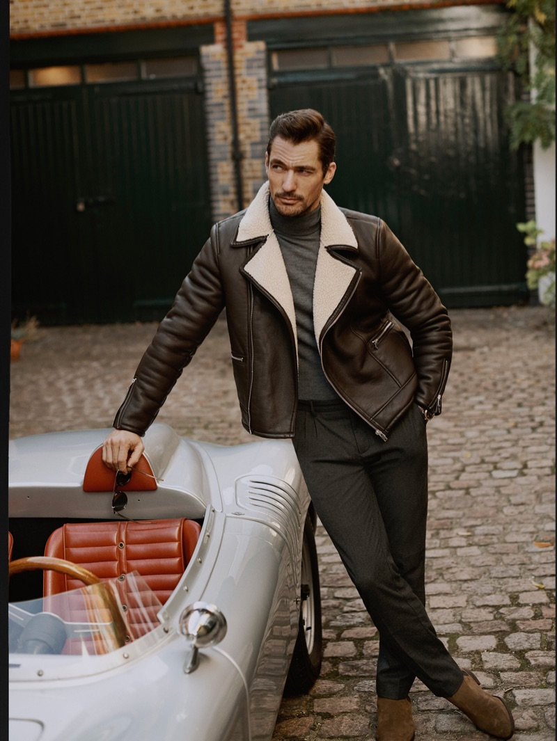 Effortlessly cool, David Gandy wears leather biker jacket with trousers from Mango.