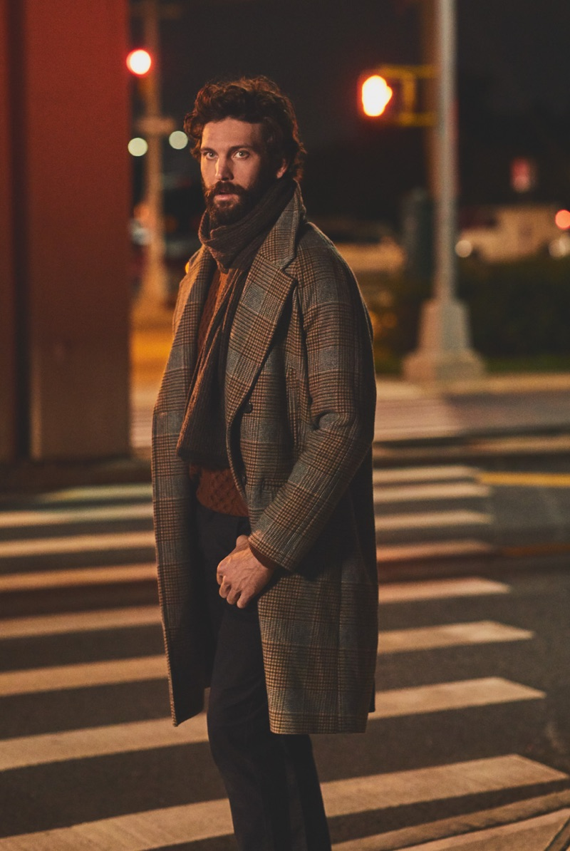 David Enrico wears a Billy Reid sweater and overcoat with Vince jeans and a Rag & Bone cashmere scarf.