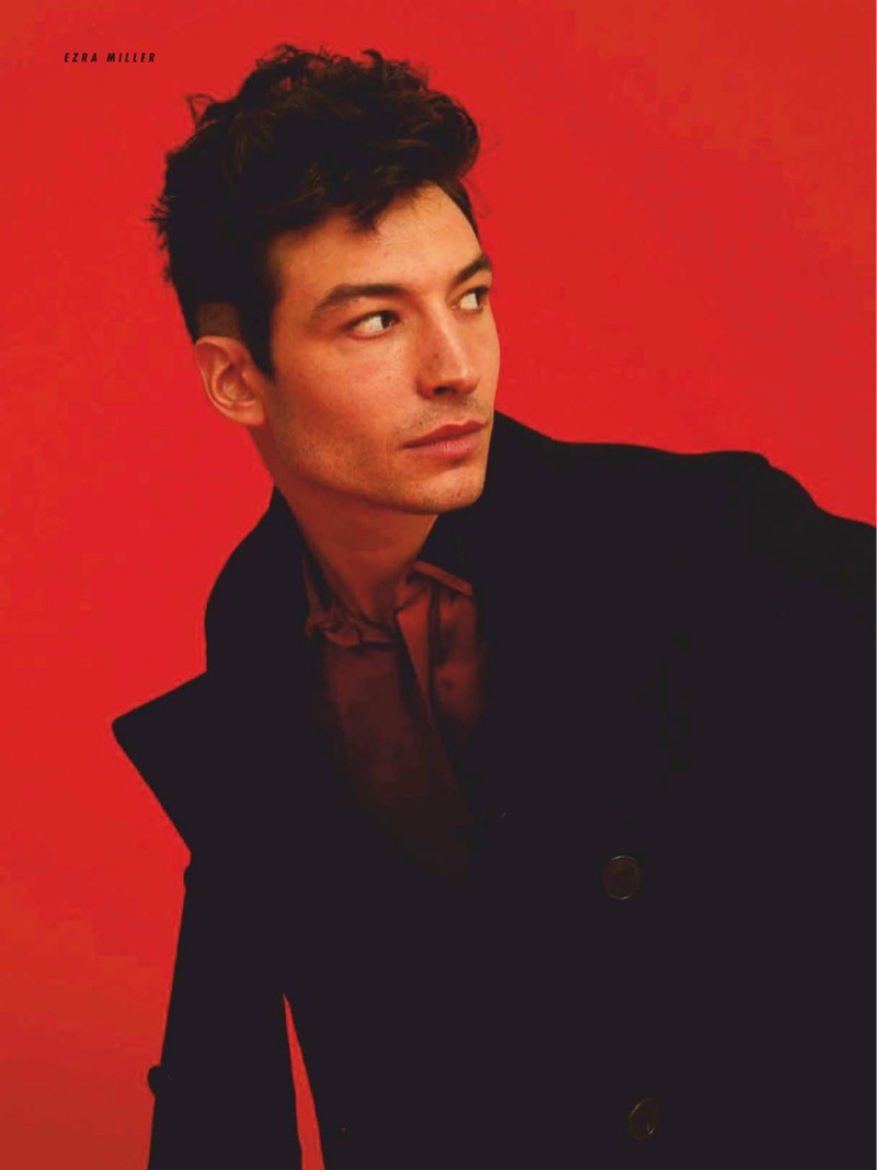 Starring in a photo shoot, Ezra Miller dons a Valentino double-breasted jacket and Saint Laurent shirt.