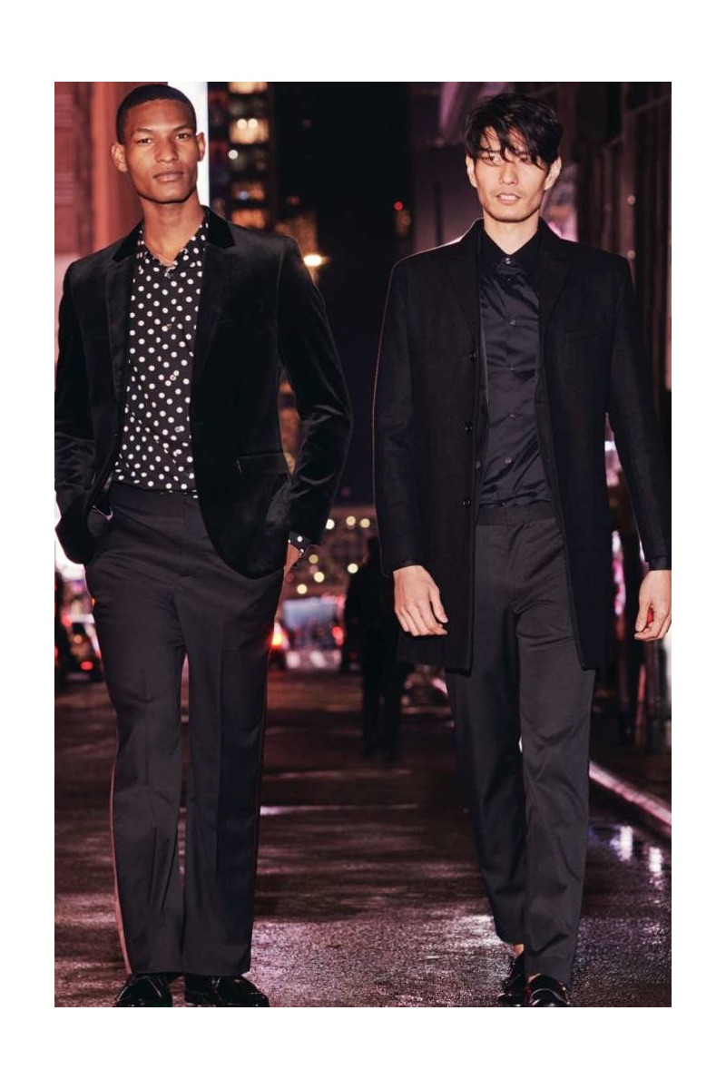 Out for a stroll, Brad Allen dons a H&M slim-fit velvet blazer, tuxedo pants, and a polka dot print shirt. Meanwhile, Daniel Liu models a H&M wool-blend coat, slim-fit stretch shirt, and suit pants.
