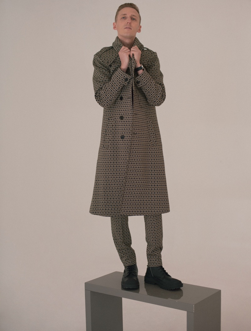 James Hatcher is sharp in a tailored coat for a fashion feature.