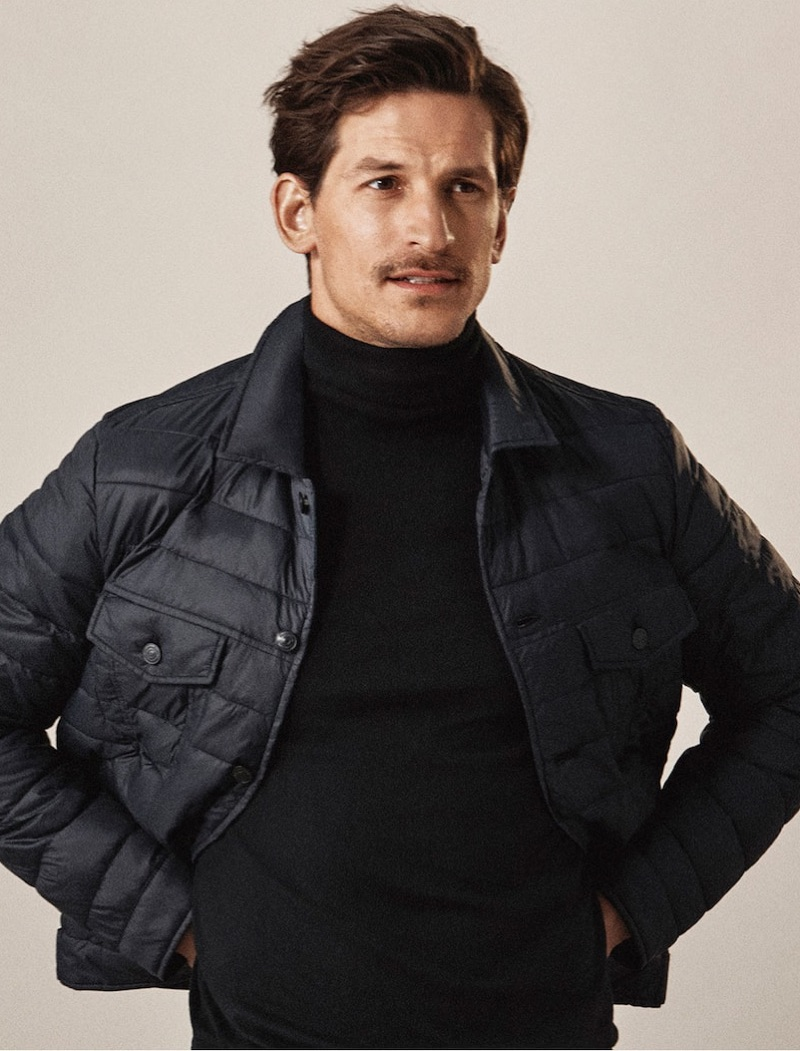 Top model Jarrod Scott wears a quilted jacket and turtleneck by Massimo Dutti.