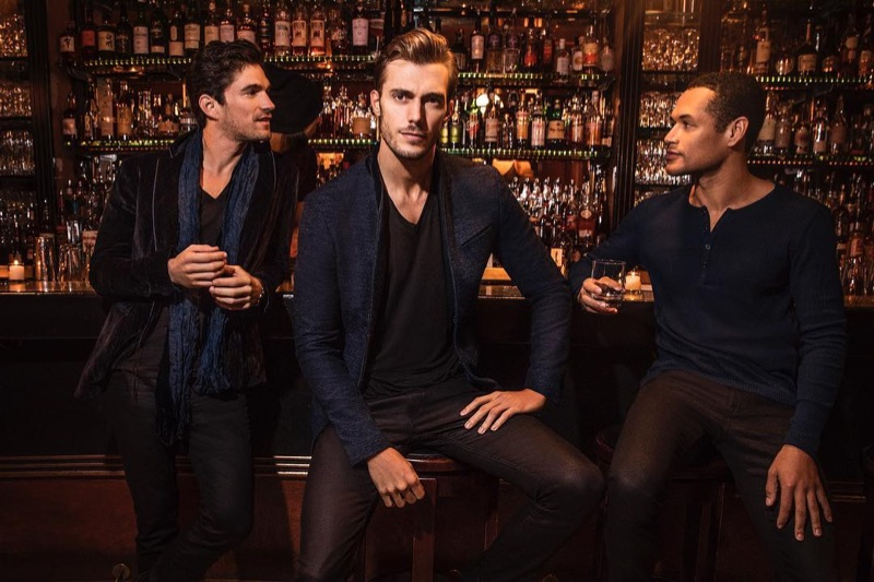 Models David Sanz, Federico Cola, and Joshua Milligan Robinson don holiday 2018 style from John Varvatos.