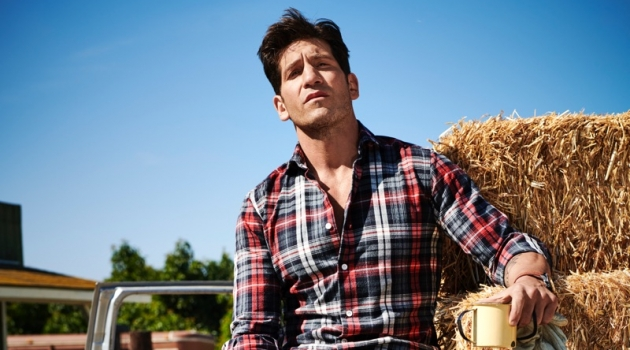Embracing rugged style, Jon Bernthal wears an Eleventy shirt, Dolce & Gabbana jeans, Allen Edmonds boots, and a Movado watch.