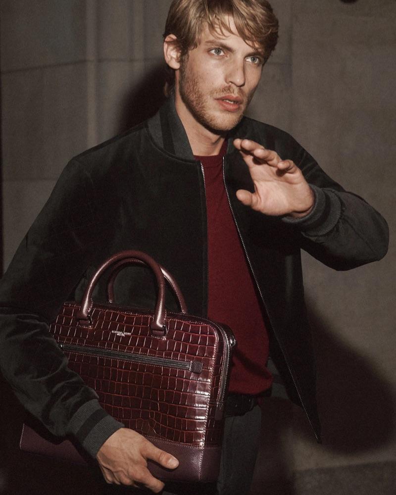 French model Baptiste Radufe sports a velvet bomber jacket for Michael Kors' holiday 2018 campaign.