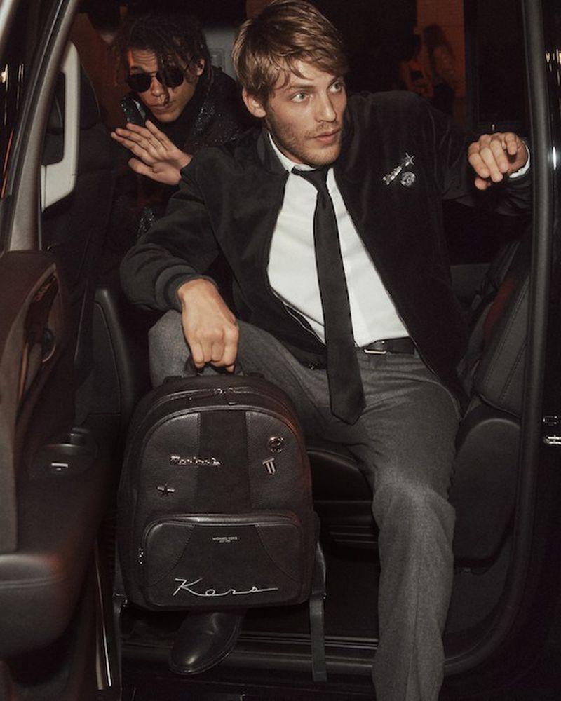 Models Baptiste Radufe and Roberto Rossellini front Michael Kors' holiday 2018 campaign.
