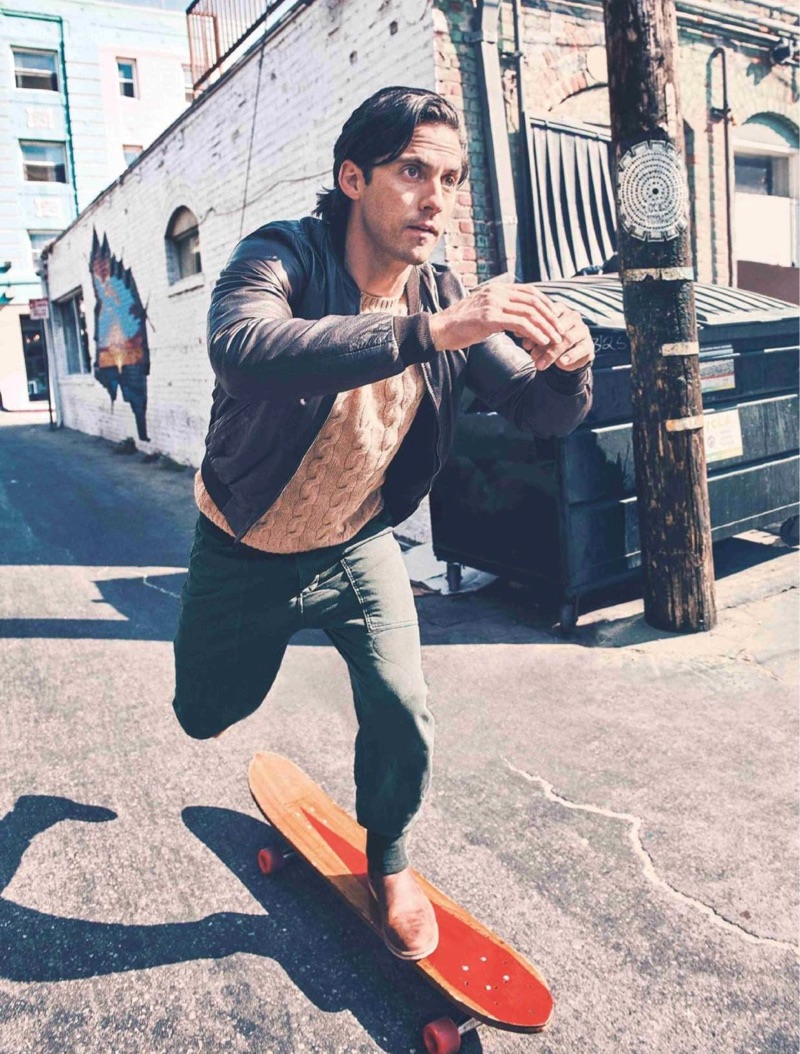 Skateboarding, Milo Ventimiglia sports a Ralph Lauren sweater, Double RL joggers, Red Wing shoes, and a Dolce & Gabbana jacket.