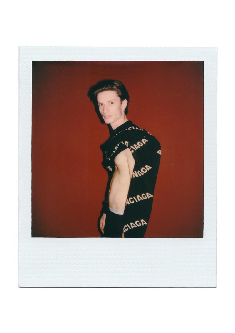 Nick wears sweater Balenciaga.