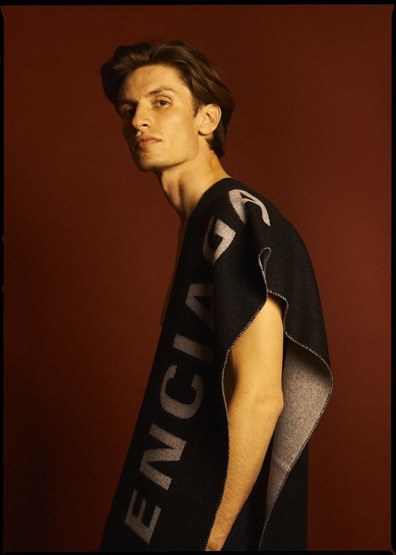 Nick wears scarf Balenciaga.